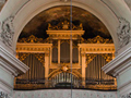 The 1858 Buckow organ tucked intp the gallery of the Piarist Church in Vienna.